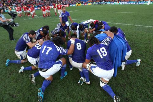Samoa pray after an international match. Photo: The Guardian UK