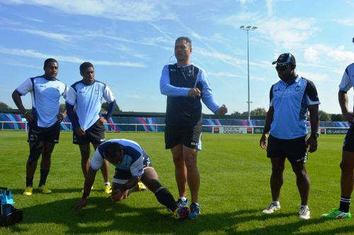 Tabai Matson (middle) trains the Fijian backline. Photo: Fiji Rugby