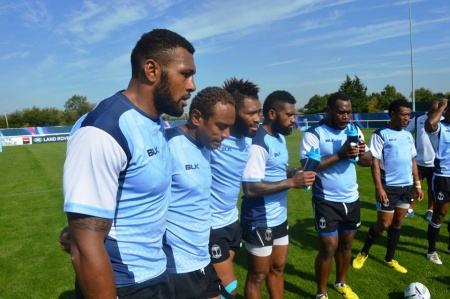 Lepani Botia (5th from left) takes a drink during training with the backs for the Fijian side. Photo: Fiji Rugby