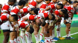 Japan celebrate their 26-5 win after the game against Samoa. Photo: Reuters / Darren Staples Livepic