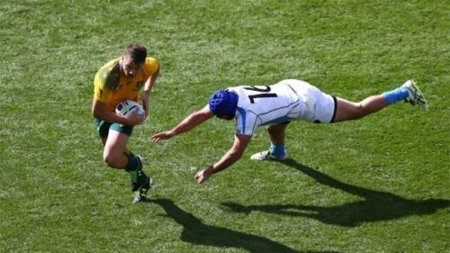 Skipper Nicolas Klappenbauch may have missed a tackle from Wallaby Drew Mitchell . . .