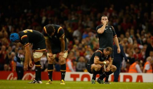 Wales players show exhaustion more than celebration after the final whistle. Photo: WalesOnline