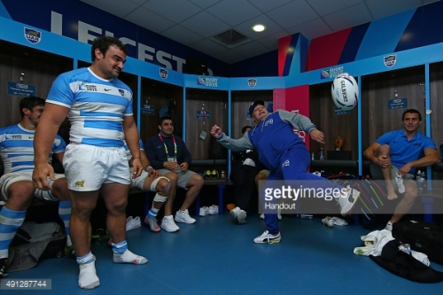 Soccer legend Diego Maradona juggles a rugby ball in the Pumas dressing room at the Leicester City Stadium after the 45-16 win over Tonga.