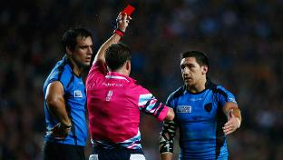 Uruguay halfback Agustin Ormaechea gets the marching orders from England's JP Doyle. Photo: World Rugby