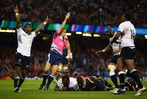 Fiji's Vereniki Goneva scores a try against Wales last Friday. Photo: The Guardian UK