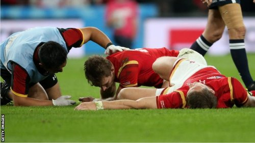Injured Welsh players on the deck during the match against England. Photo: Getty Images