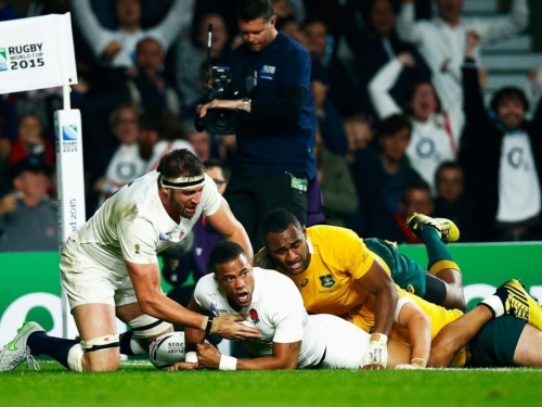 Even a try by England winger Anthony Watson could not stop the Australian dominance of the game. Photo: Planet Rugby